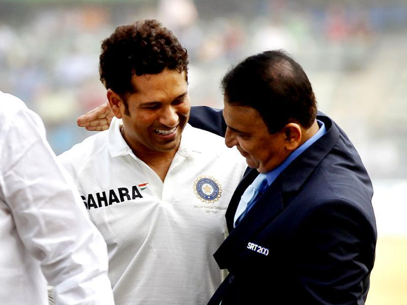 Legendary cricketer Sunil Gavaskar greets Sachin Tendulkar during the release of the postal stamp honouring the latter on his last Test match against West Indies at Wankhede Stadium in Mumbai. (Ajay Aggarwal/ HT photo)