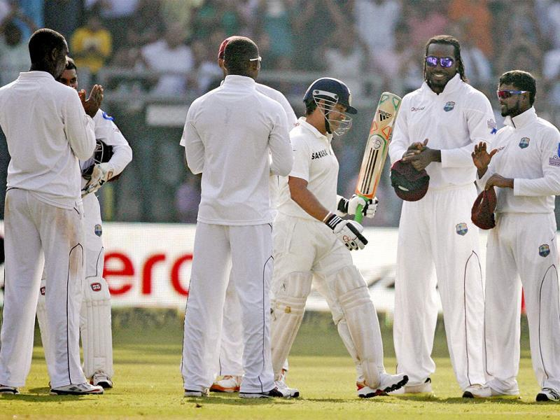 West Indian players clap to pay their respect to Sachin Tendulkar as he arrives to bat on Day 1 of their 2nd test match at Wankhede Stadium in Mumbai. (PTI/Shashank Parade)