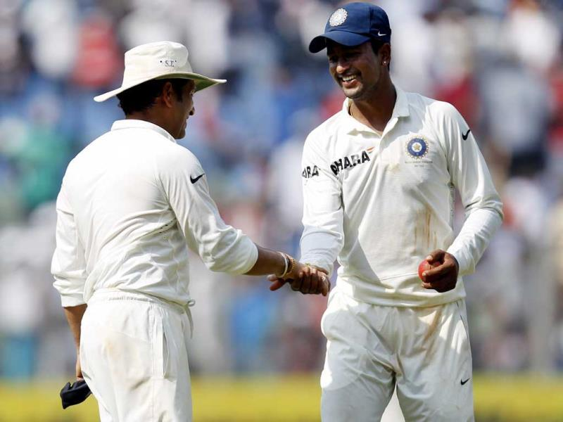 Sachin Tendulkar congratulates Pragyan Ojha after the West Indies 1st inning during the 2nd cricket Test match between India and West Indies at Wankhede Stadium in Mumbai. HT Photo/Ajay Aggarwal