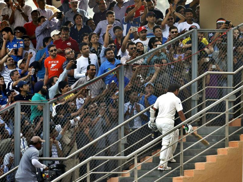 Sachin Tendulkar leaves the ground after his dismissal during his last and 200th Test match against West Indies at Wankhede Stadium. (Ajay Aggarwal/ HT photo)