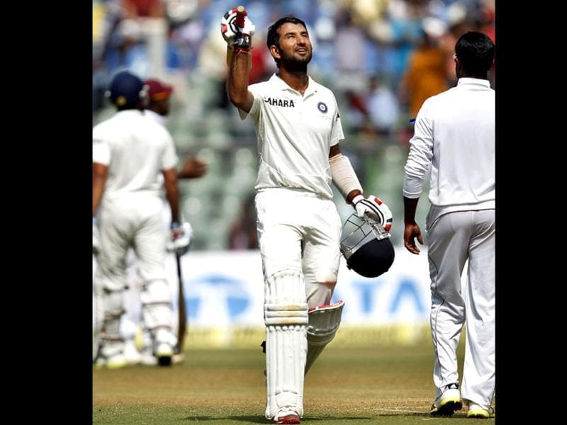 Cheteshwar Pujara celebrates his 5th Test century during the second Test match against West Indies at Wankhede Stadium. (Ajay Aggarwal/ HT photo)