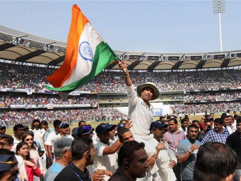 Sachin takes a lap of the ground as his teammates carry him on their shoulders in Mumbai. (PTI Photo)