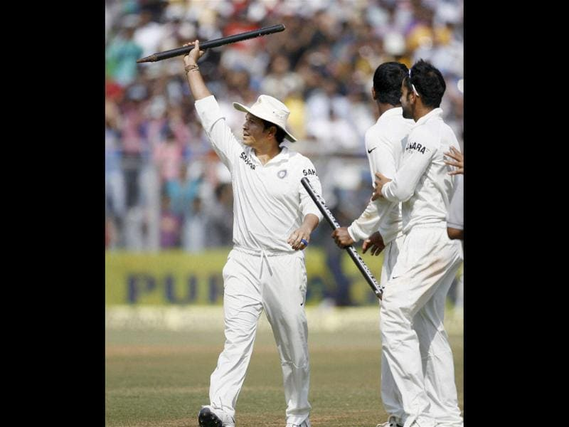 Sachin Tendulkar carries a stump as he walks out of the ground after India beat West Indies at Wankhede in Mumbai. (PTI Photo)