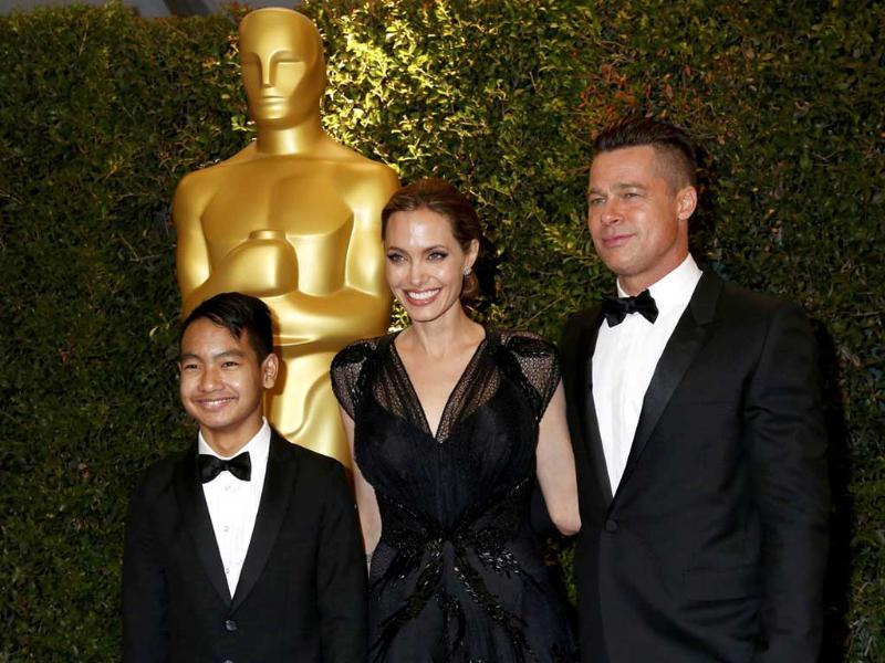 US actress Angelina Jolie with partner Brad Pitt and son Maddox arrive at the 5th Annual Academy of Motion Picture Arts and Sciences Governors Awards in Hollywood. (Reuters Photo)