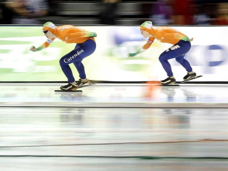 Ireen Wust of the Netherlands, right, races teammate Lotte van Beek in the women's 1,500 meter during the Essent ISU speedskating World Cup at Utah Olympic Oval. (AP Photo)