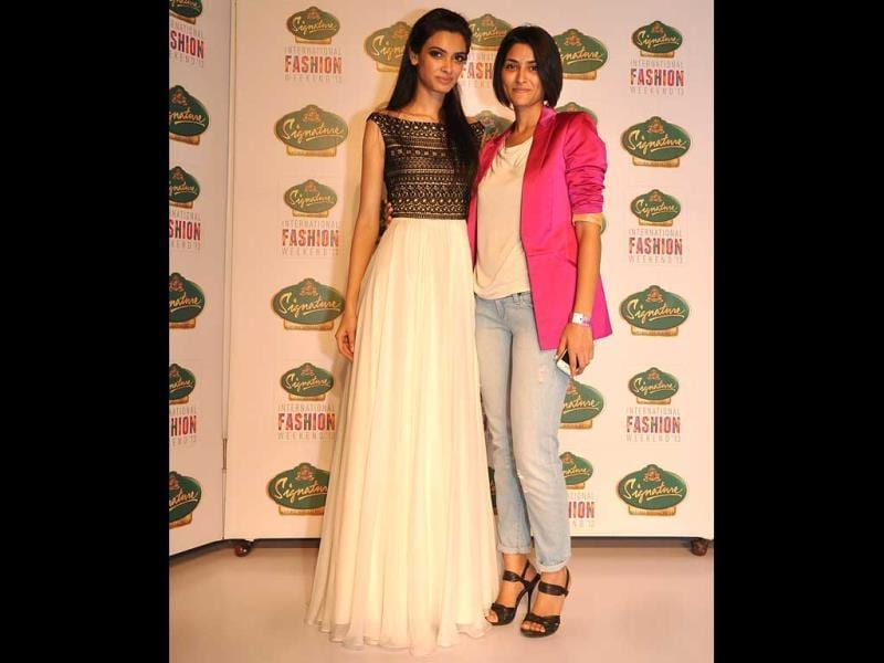 Diana Penty looks demure as she poses along with designer Drashta in one of her creations.