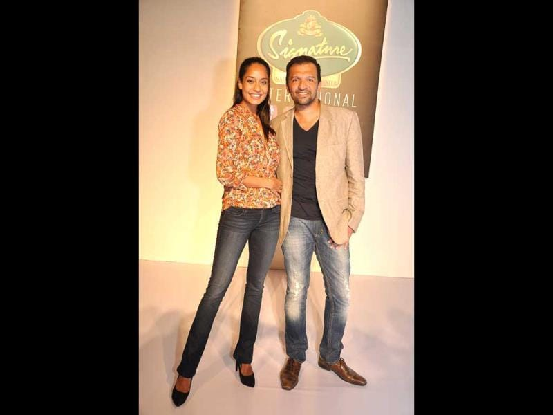 Actor Lisa Hayden and photographer Atul Kasbekar pose in Mumbai on the sidelines of a fashion week.