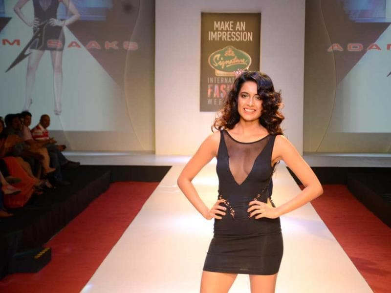 Sarah Jane Dias oozes oomph as she scorches the catwalk in a little black number by designer Adam Saaks.