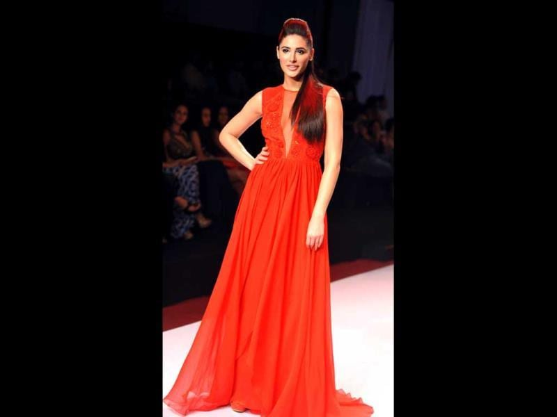As Mumbai hosted a fashion weekend, Bollywood divas donned their designer togs and won the style stakes hands down. Actor Nargis Fakhri looked red hot in a Nachiket Barve creation as she walked the ramp.