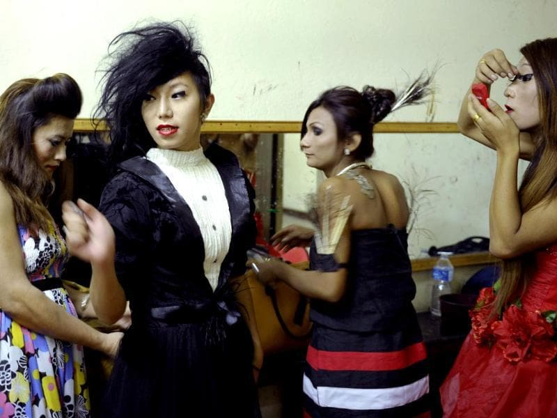 Nepalese transgendered performers put on make up before a show in Kathmandu. (AFP Photo)