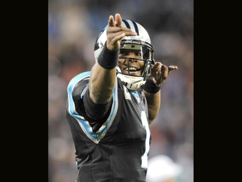 Carolina Panthers' Cam Newton (1) reacts after making a first down against the New England Patriots during the first half of an NFL football game in Charlotte. (AP Photo)