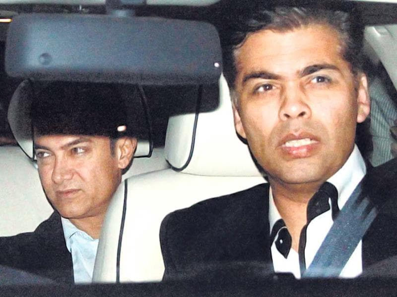 Aamir Khan and wife Kiran Rao drove in with Karan Johar.