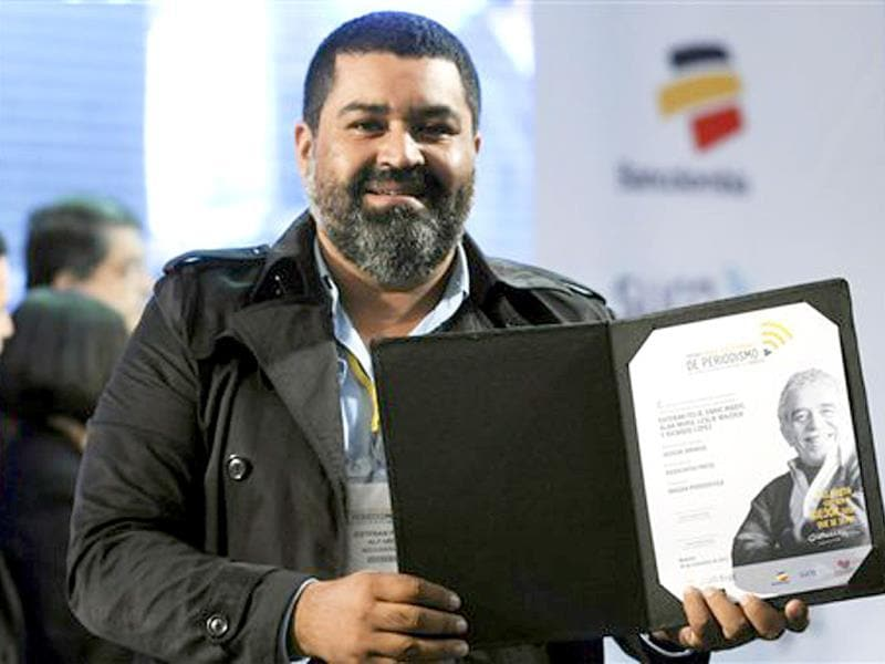 Esteban Felix, an Associated Press photographer from Peru who is based in Nicaragua, shows his Gabriel García Márquez International Journalism Award for visual journalism at the awards ceremony in Medellin, Colombia. Felix was honored for his multimedia project about sugar cane workers affected by chronic kidney disease in Nicaragua. (AP Photo)