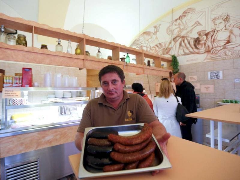 Downtown butcher Tamas Balla shows off his sausages in Budapest. Budapest offers a wealth of choices for lovers of music, art and architecture in a beautiful setting on the Danube river. (Reuters Photo)
