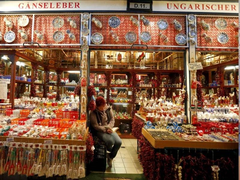 A shopkeeper at a souvenir stand awaits customers in the Great Market Hall in Budapest. (Reuters Photo)