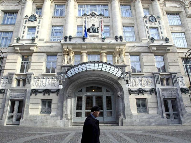A man walks past the freshly restored facade of the Franz Liszt Academy of Music in Budapest. (Reuters Photo)