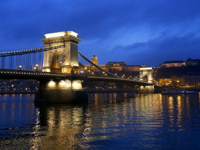 The iconic Chain Bridge of Budapest spans the Danube river and the Royal Palace is seen in the background. (Reuters Photo)