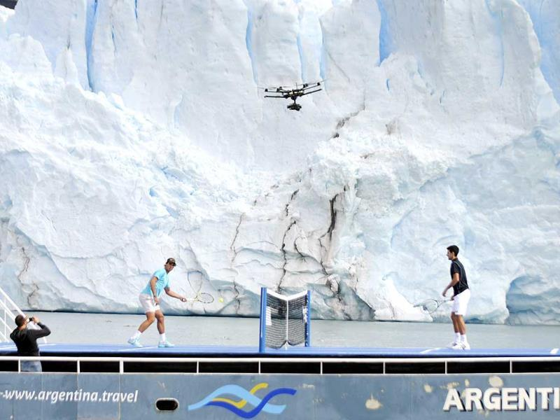 Novak Djokovic (R) of Serbia and Rafael Nadal of Spain play an exhibition tennis match at a court set up on the deck of a ship, as the Perito Moreno glacier is seen in the background, near the Patagonian city of El Calafate. Djokovic and Nadal are in Argentina to attend a farewell event on Sunday for Argentina's David Nalbandian, who is retiring from professional tennis. (Reuters)