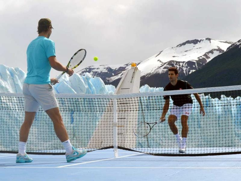 In this picture released by Argentina's Ministry of Tourism, tennis players Rafael Nadal, left, and Novak Djokovic play an exhibition match on a boat in front of Glacier Perito Moreno near El Calafate, Argentina. (AP Photo)