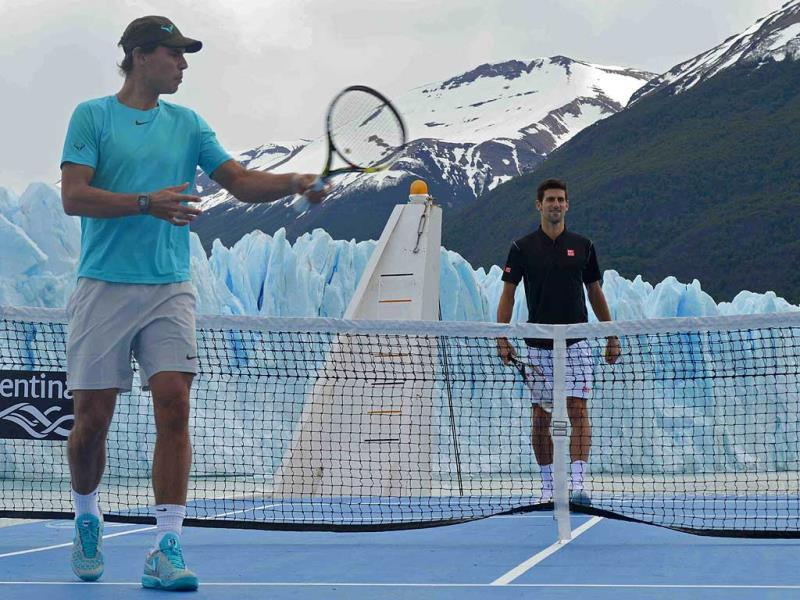In this picture released by Argentina's Ministry of Tourism, tennis players Rafael Nadal, left, and Novak Djokovic pose in front of Glacier Perito Moreno from a tennis court on a ship where they played an exhibition game near El Calafate, Argentina. (AP Photo)