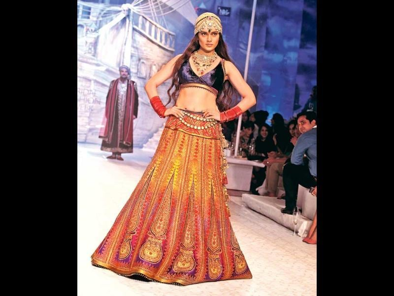 A must-have accessory this season, it is not that difficult to style a turban. Just tone down the other accessories and jazz up the headgear. Kangana Ranaut walks the ramp sporting a turban.