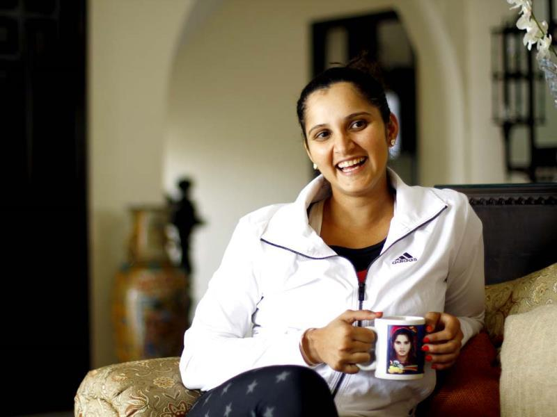 Sania Mirza is all smiles before an interview with HT in her house in Hyderabad. A steaming mug of chai keeps her company. (Ajay Aggarwal/HT photo)
