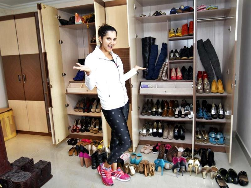 From knee-length boots to neon coloured heels, from flats to wedges, over 300 pairs of shoes make up Sania Mirza's shoe cupboard! (Ajay Aggarwal /HT photo)