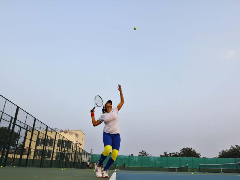 In the newly-opened Sania Mirza Tennis Academy in the outskirts of Hyderabad, the tennis star perfects her serve. (Ajay Aggarwal/HT photo)