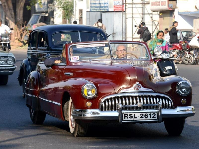 A 1947 Buick Eight car driven by Subodh Nath is pictured during the Vintage Car Rally in Ahmedabad. (AFP Photo)