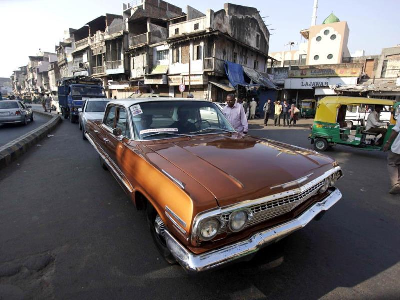A man drives his vintage Chevrolet during a vintage car rally in Ahmadabad. The rally was held as part of the World Heritage Week celebrations. (AP Photo)