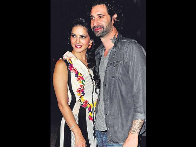 Sunny Leone and husband Daniel Weber at a promotional event for her upcoming film Jackpot.