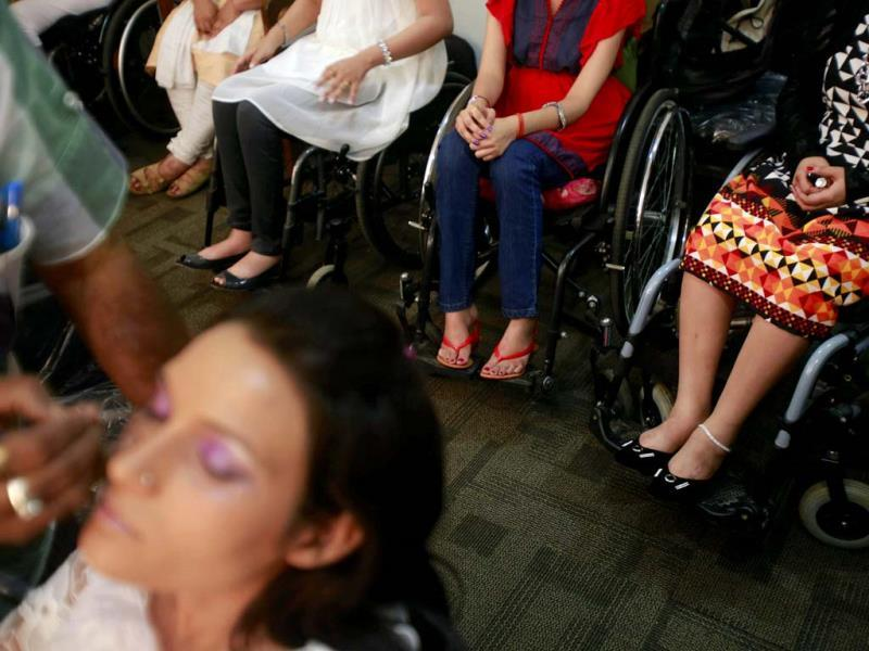 A contestant gets her make up done. (AP Photo)