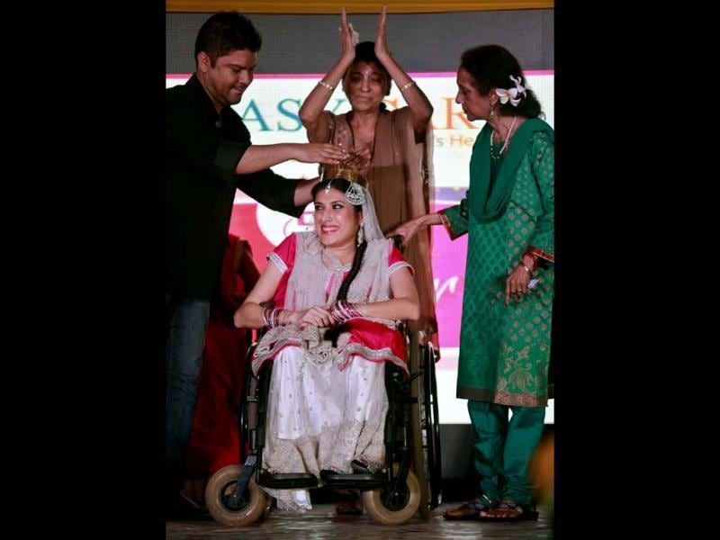 Nirmala, center, is crowned Miss Wheelchair India beauty at the final of the contest. (AP Photo)