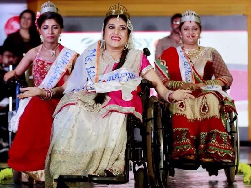 Nirmala, centre, smiles after being named Miss Wheelchair India Beauty during a beauty contest in Mumbai on November 24. 15 handicapped contestants took part in the event. (PTI Photo)