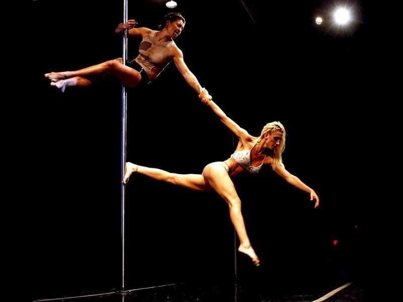 Ekaterina Malykhina and Tallyta Torres of Brazil perform during the doubles category at the Miss Pole Dance South America 2013 competition in Buenos Aires. (Reuters Photo)