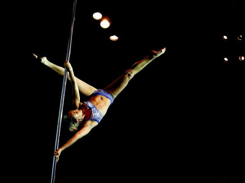 Pole dancer Florencia Murga of Argentina performs in the Miss Pole Dance South America 2013 and Pole Dance Argentina 2013 competitions in Buenos Aires, Argentina. (AP Photo)