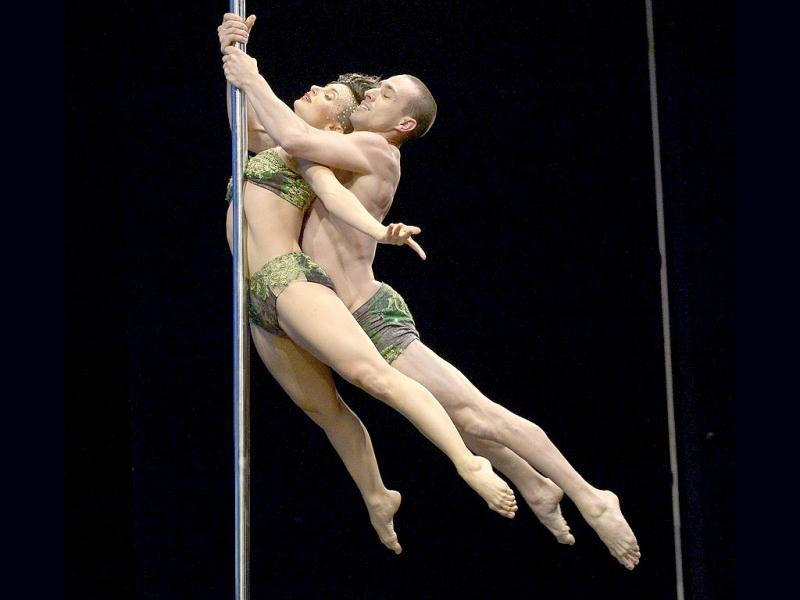 Argentine pole dance couple Belen Serra and Joaquin Dezzoti compete en route to a second place finish in the double during the South America 2013 Pole Dance competition in Buenos Aires. (AFP Photo)