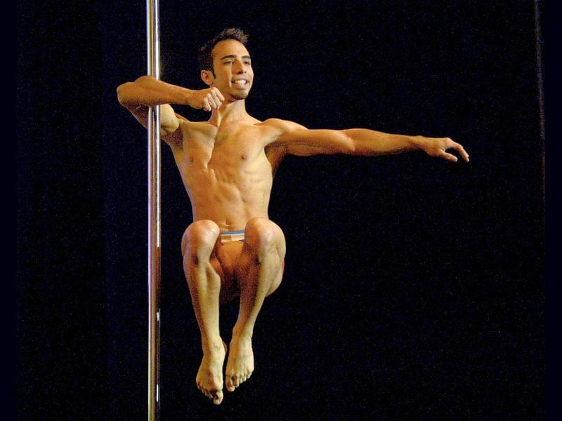 Venezuelan pole dancer Gregoris Garcia competes en route to winning in the Male South America 2013 Pole Dance competition in Buenos Aires. (AFP Photo)