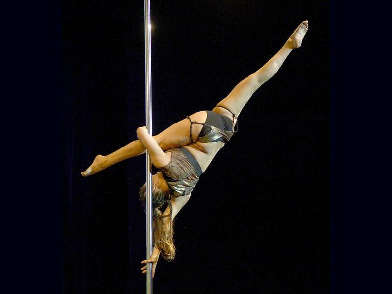 Peruvian pole dancer Mariela Duffo competes in the South America 2013 Pole Dance competition in Buenos Aires. (AFP Photo)