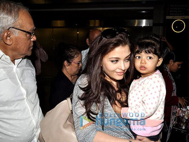 Are they clicking us mommy? Aaradhya seems to have finally noticed the shutterbugs.