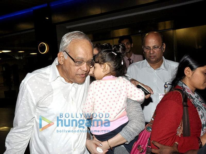 Sharing a secret, Aaradhya? Ash's father is all ears as Aaradhya coos in her sweet voice.
