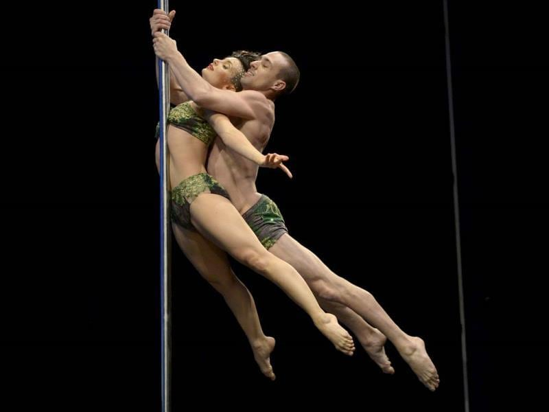 Argentine pole dance couple Belen Serra and Joaquin Dezzoti compete en route to a second place finish in the double during the South America 2013 Pole Dance competition in Buenos Aires.(AFP photo)