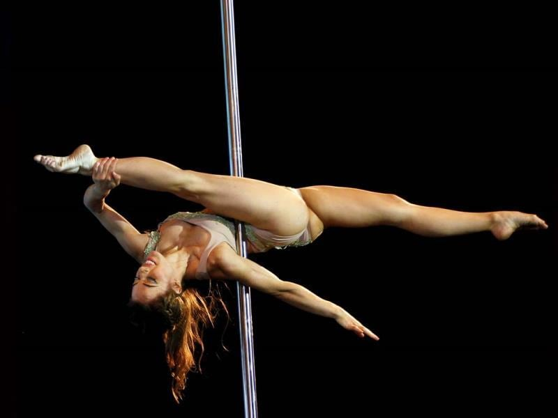 Pole dancer Maria Aguiar, of Argentina, performs in the Miss Pole Dance South America 2013 and Pole Dance Argentina 2013 competitions in Buenos Aires, Argentina (AP Photo)