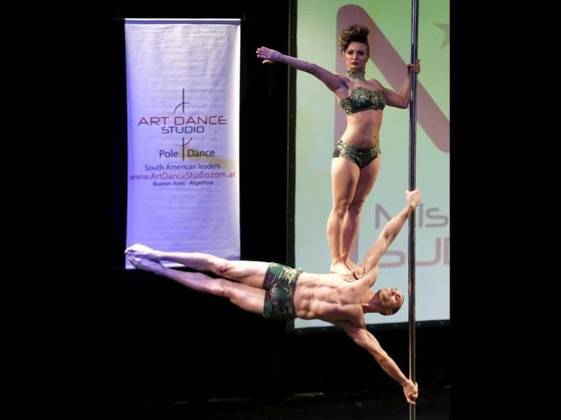 Belen Sierra (top) and Joaquin Dezzotti of Argentina perform during the doubles category at the Miss Pole Dance South American 2013 competition in Buenos Aires. (Reuters)