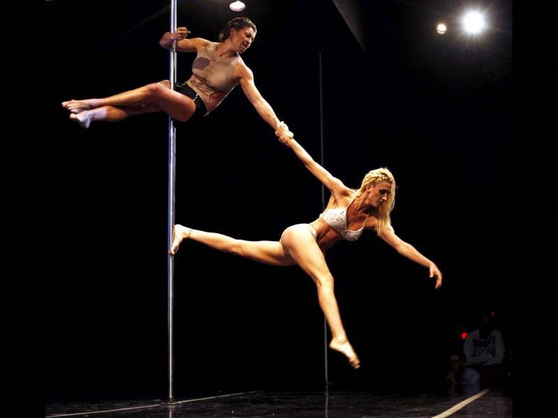 Ekaterina Malykhina and Tallyta Torres of Brazil perform during the doubles category at the Miss Pole Dance South America 2013 competition in Buenos Aires. (Reuters)