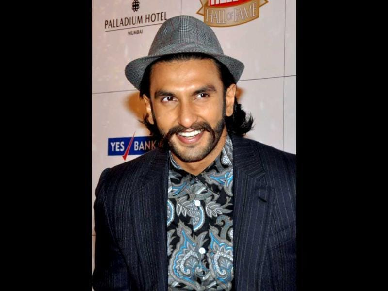 With a hat and his trademark moustache-beard, Ranveer Singh stands out from the tuxedo crowd.