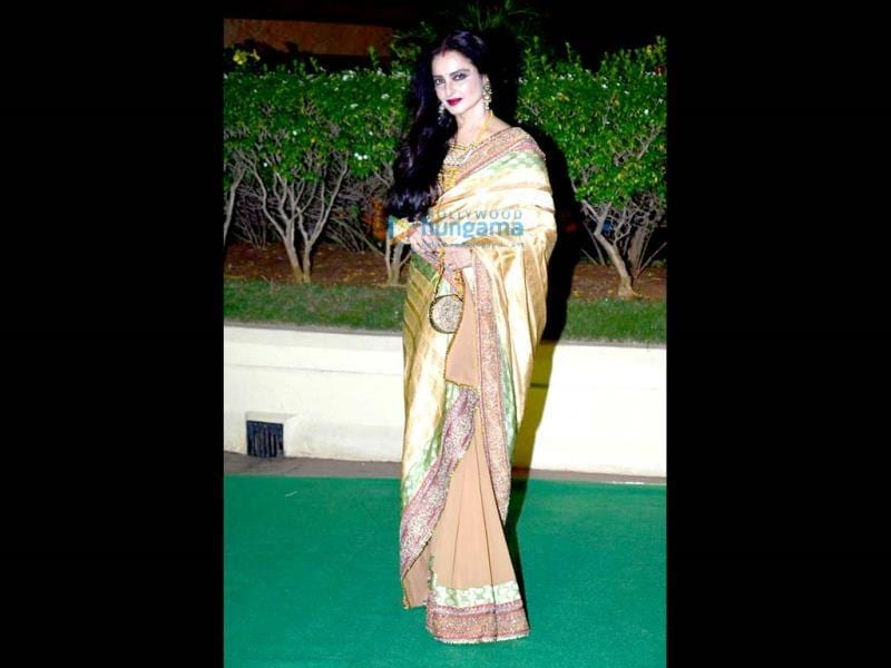 Rekha looked elegant in a sari.