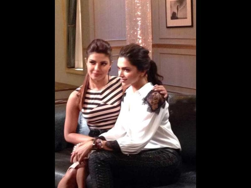 Priyanka Chopra, Deepika Padukone get cosy on the sets of Koffee with Karan 4.