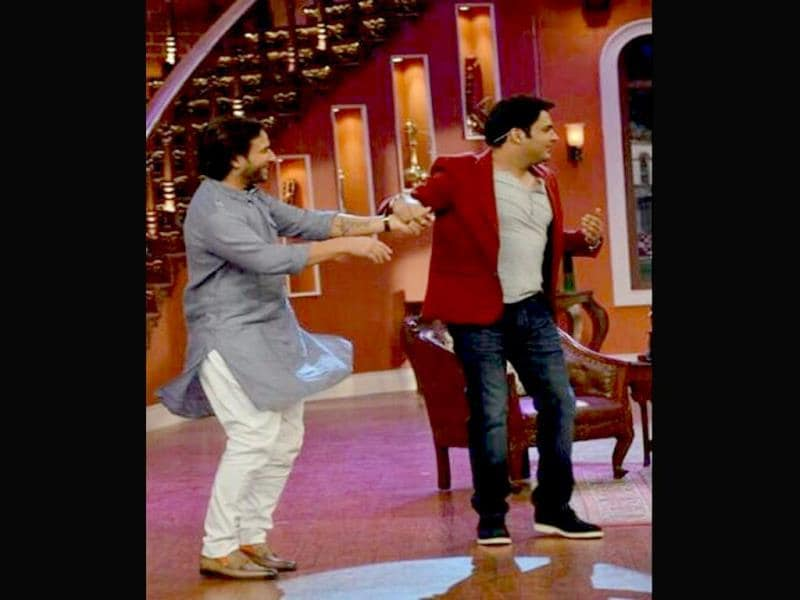 Saif Ali Khan fools around with Kapil Sharma on the sets of his comedy show.