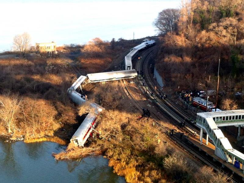 Cars from a Metro-North passenger train are scattered after the train derailed in the Bronx neighborhood of New York. (AP Photo)